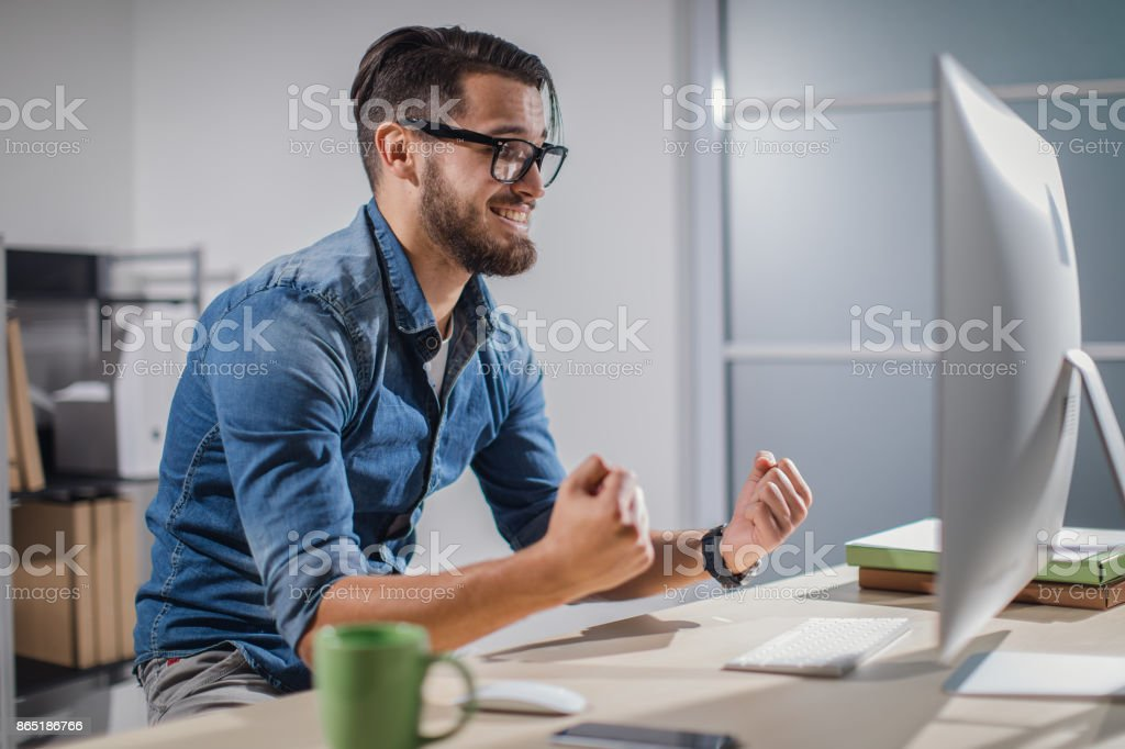 Young businessman working late stock photo