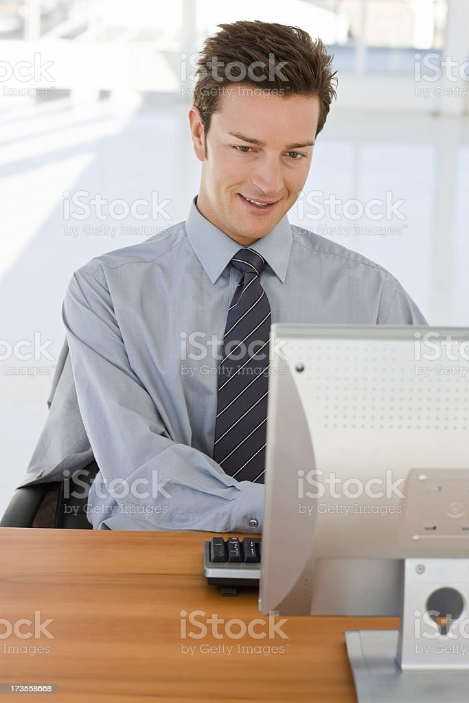 Young businessman working on computer royalty-free stock photo
