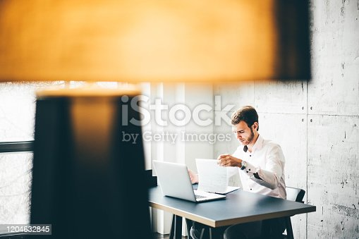 1161068403 istock photo Young businessman working 1204632845