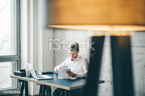 1161068403 istock photo Young businessman working 1204632849