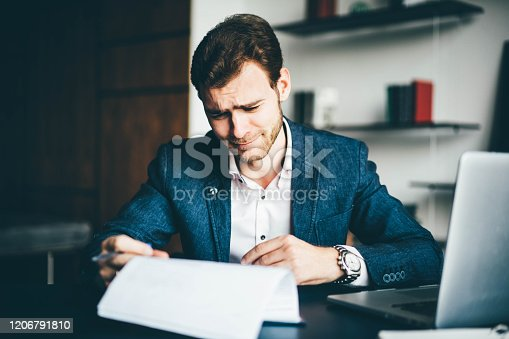 639105488 istock photo Young businessman working 1206791810