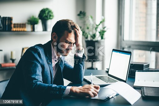 639105488 istock photo Young businessman working 1206791816