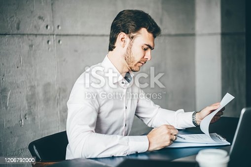 1161068403 istock photo Young businessman working 1206792000