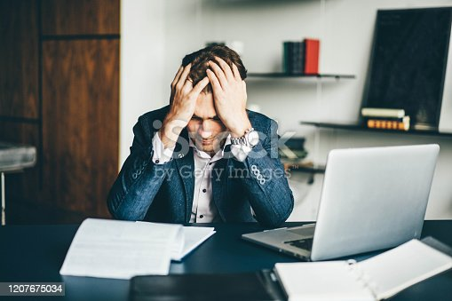 639105488 istock photo Young businessman working 1207675034