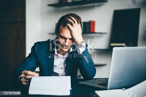 639105488 istock photo Young businessman working 1207675036
