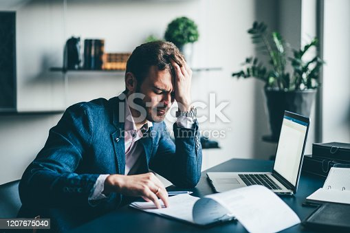 639105488 istock photo Young businessman working 1207675040