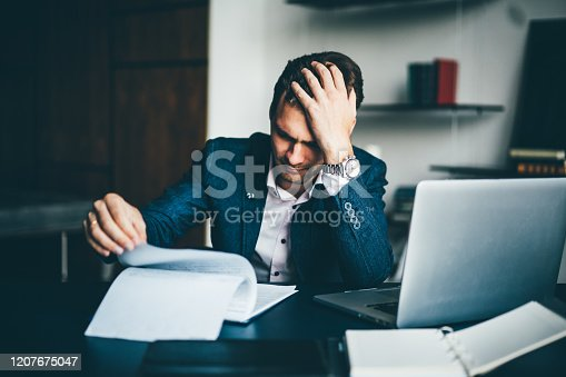639105488 istock photo Young businessman working 1207675047