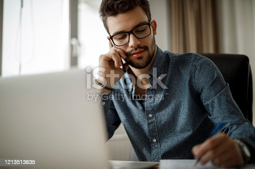913346608 istock photo Young businessman working 1213513635