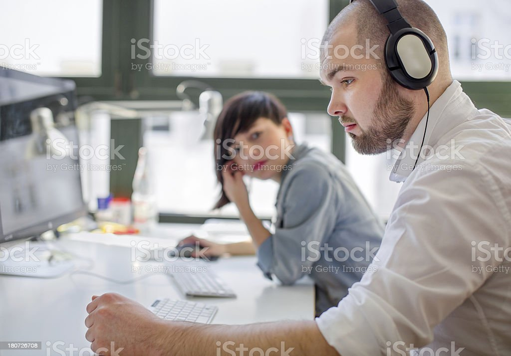 Young Businessman working with Headphones stock photo