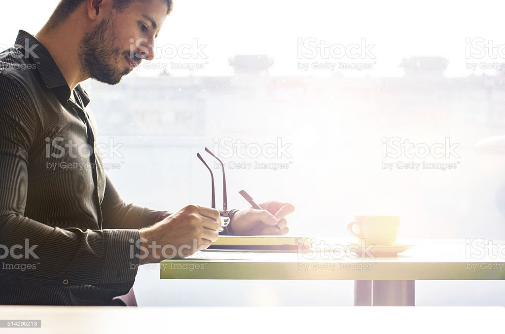 Young businessman writing stock photo