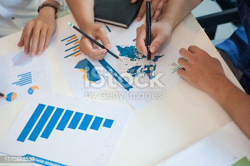 669853862 istock photo Young businessmen meet to discuss business planning and marketing. 1172688539
