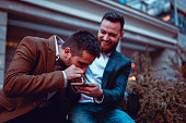 istock Young Businessmen Snorting Cocaine After Work 1185741511