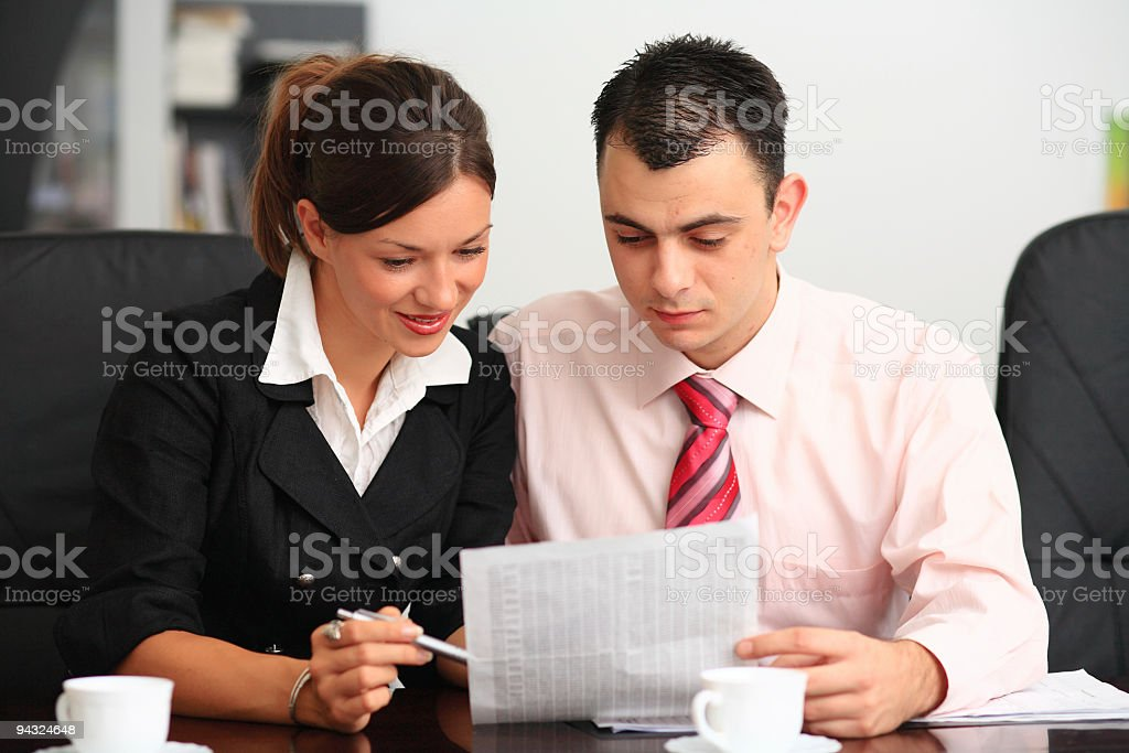 Young businesspeople having meeting in the office royalty-free stock photo