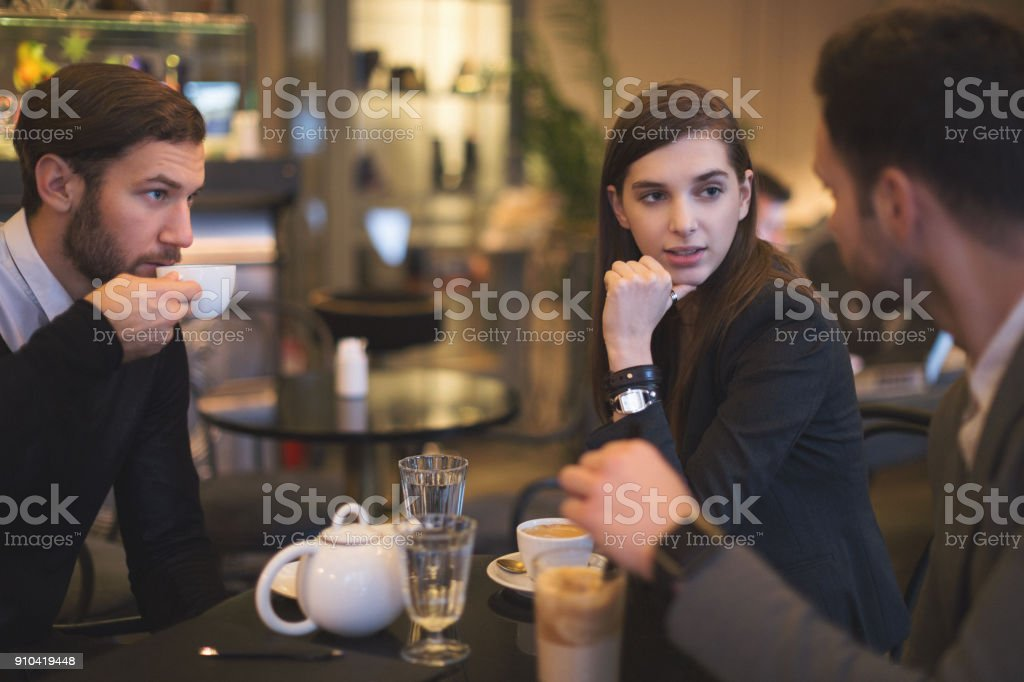 Young businesspeople working in restaurant stock photo