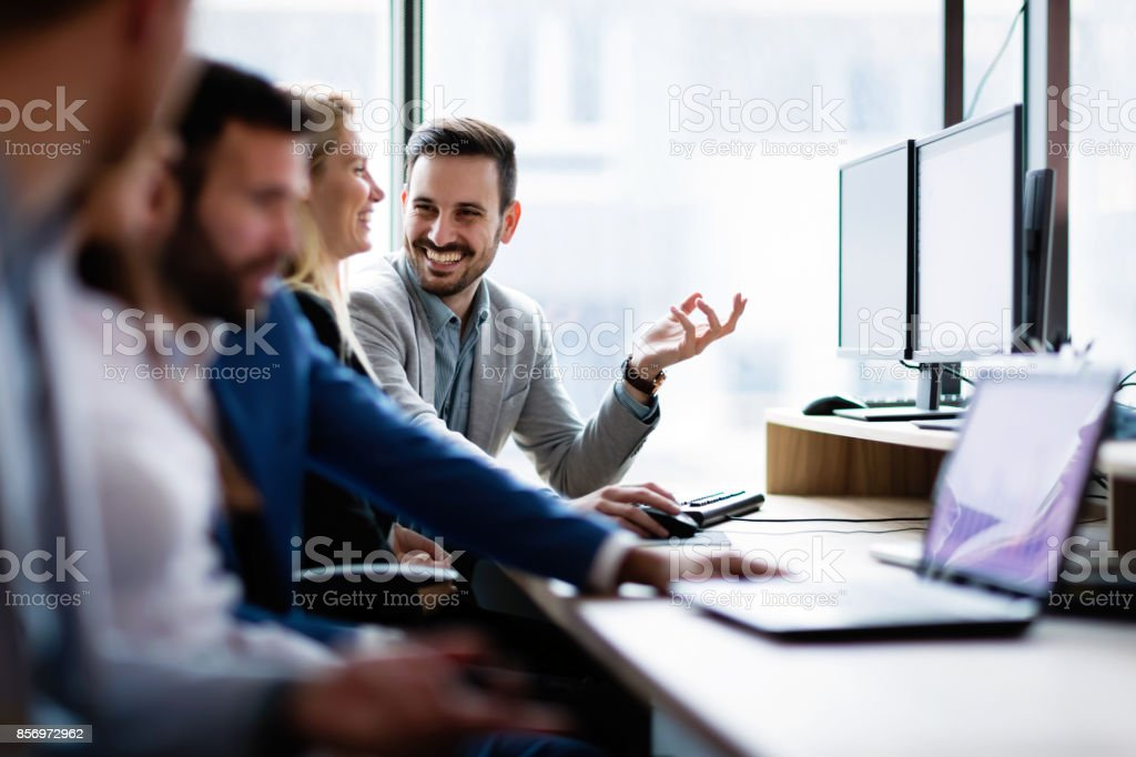 Young businesspeople working on computer in office royalty-free stock photo