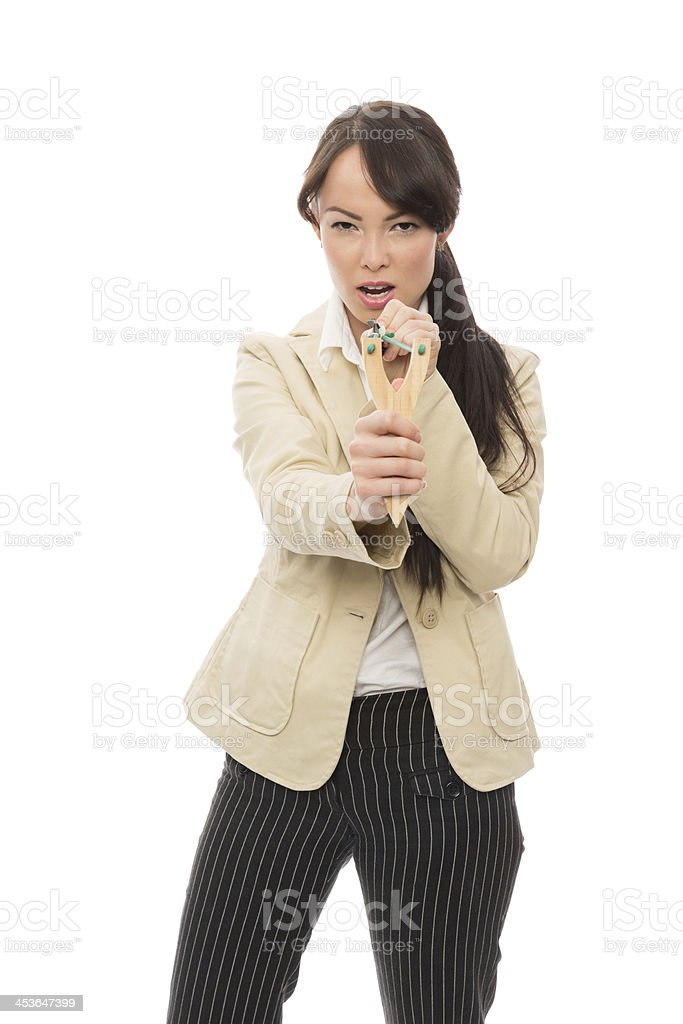 Young Businesswoman Aiming With Slingshot royalty-free stock photo