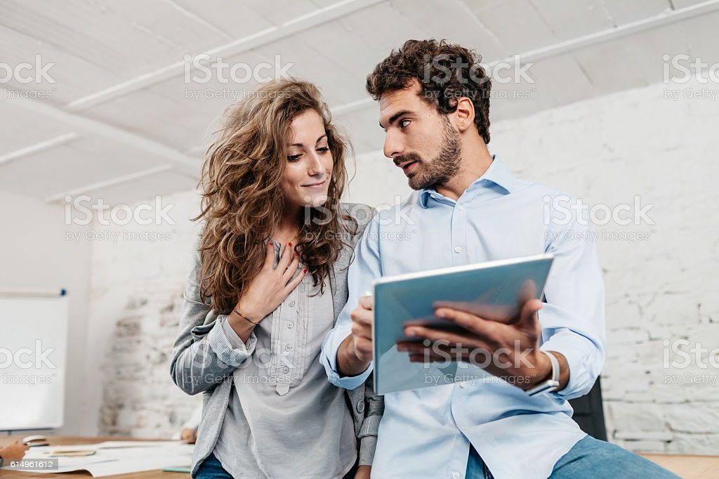 Young businesswoman and businessman working in office – Foto