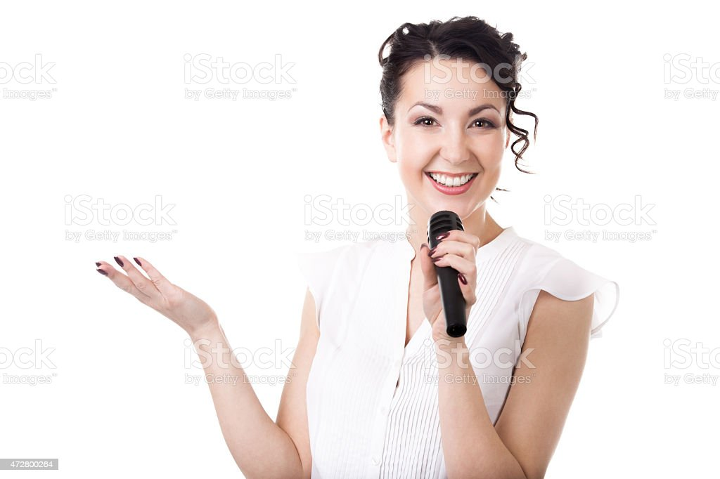 Young businesswoman announcer with microphone on white backgroun stock photo