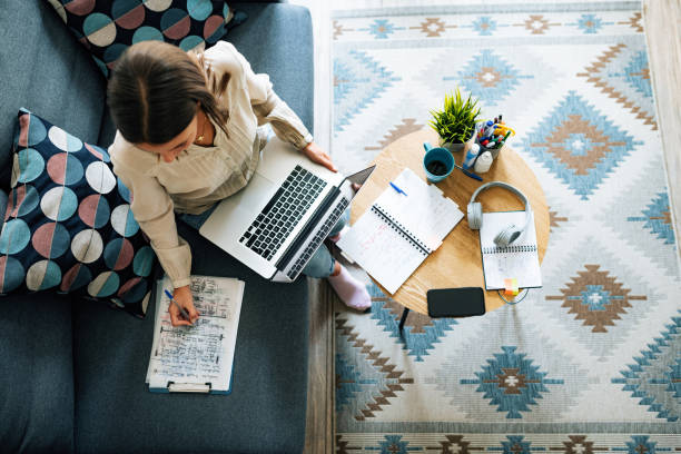 Young businesswoman at home having video call and telecommuting