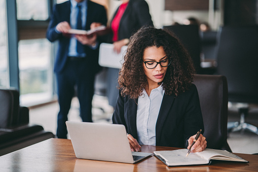 Mixed race businesswoman working in office