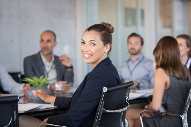 young businesswoman attending meeting - latina woman stock photos and pictures