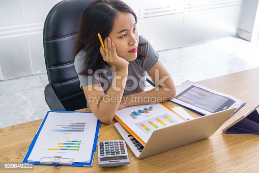 istock Young businesswoman carrying a pen thinking of new inspiration 639649222