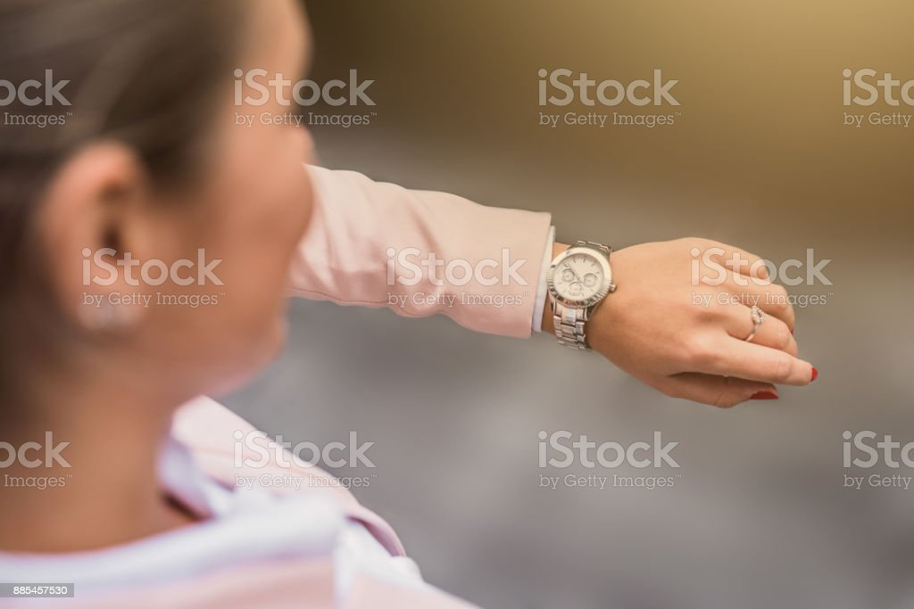Young businesswoman checking time. stock photo