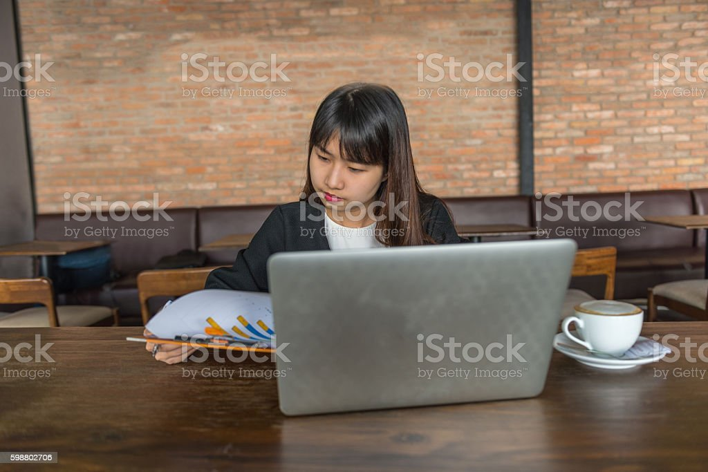 Young businesswoman concentrate on checking report and data stock photo