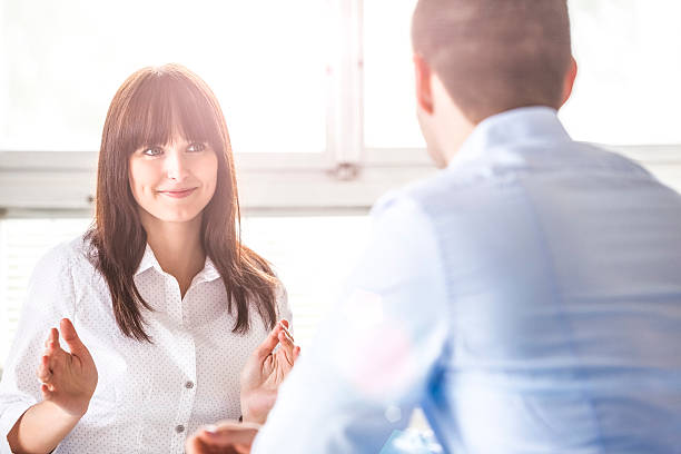 Young businesswoman discussing with male colleague in office – Foto