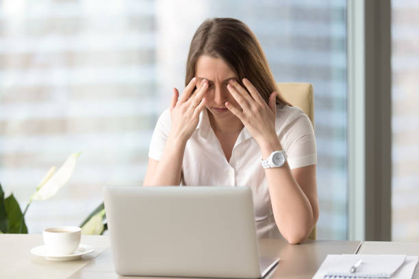 young businesswoman doing exercises to relieve tired of computer eyes - eyelid stock photos and pictures