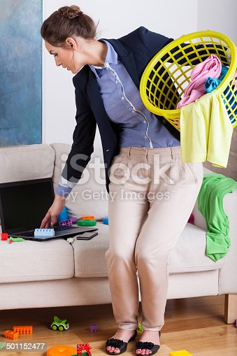 istock Young businesswoman doing the housework 501152477