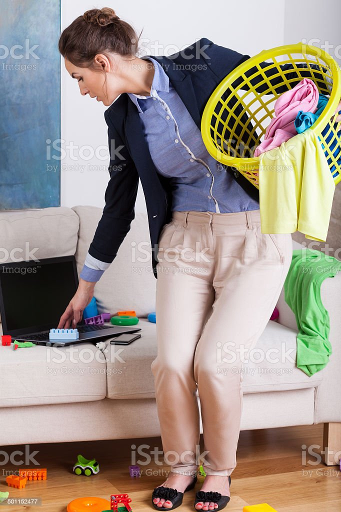 Young businesswoman doing the housework stock photo