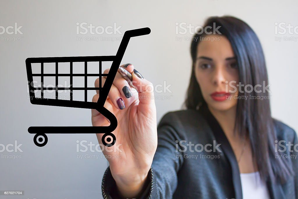 Young businesswoman drawing shopping cart stock photo