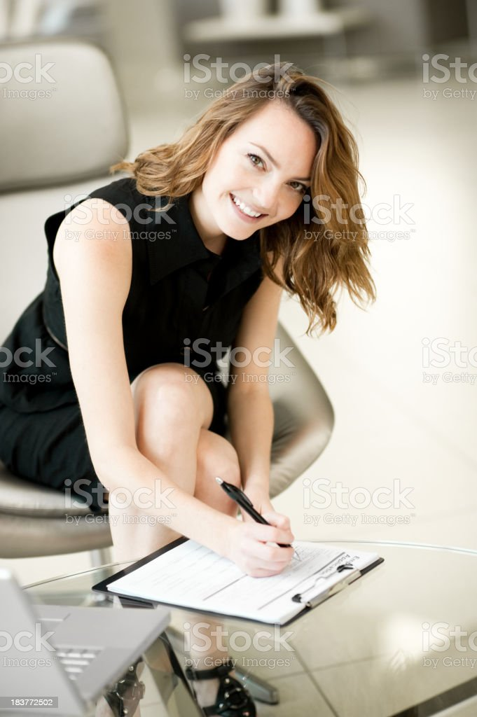 Young Businesswoman Filling Out Job Application royalty-free stock photo