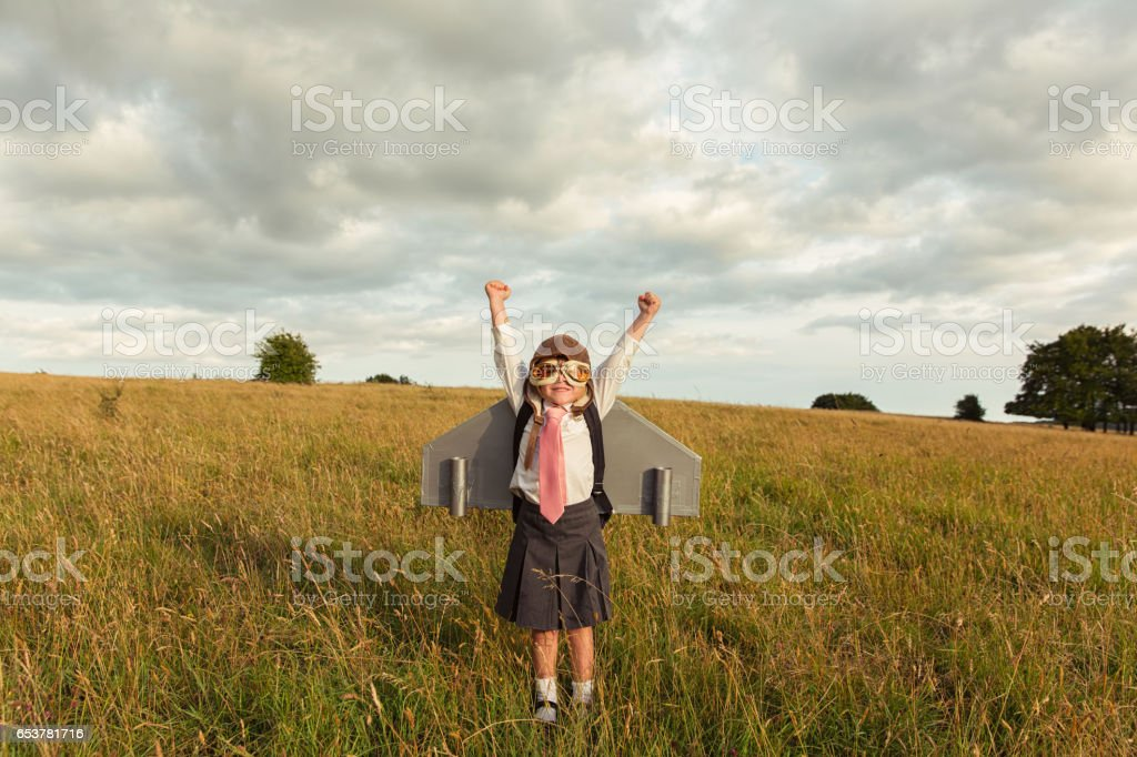 Young Businesswoman Flies Jet Pack into the Sky stock photo