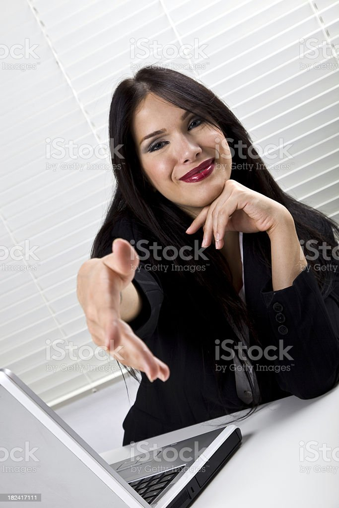 Young businesswoman giving hand royalty-free stock photo