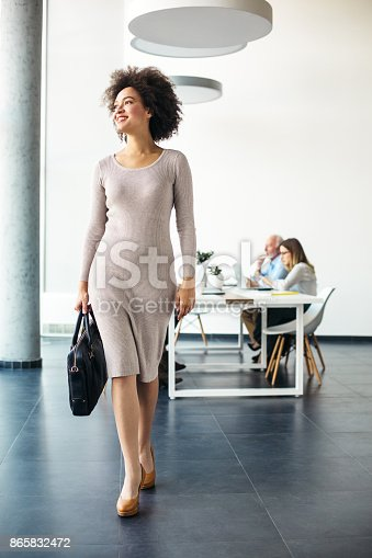 istock Young businesswoman going home from work 865832472