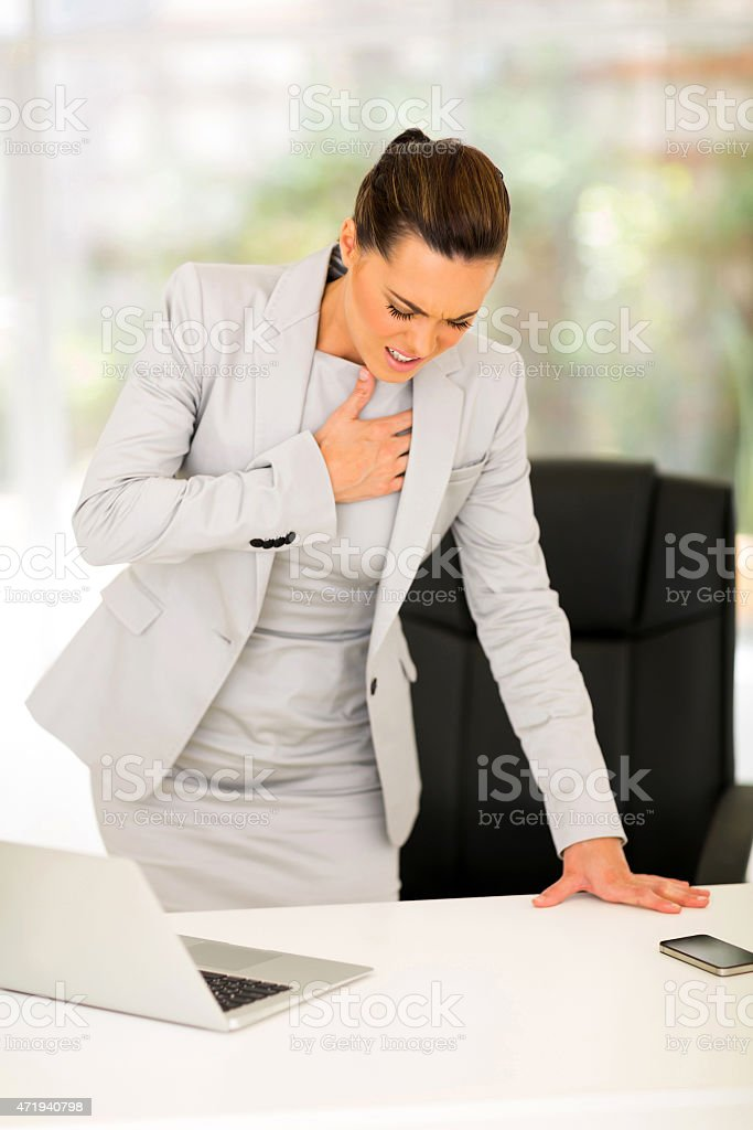 young businesswoman having heart attack stock photo