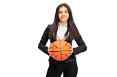 istock Young businesswoman holding a basketball 496239546