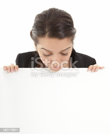 157609352 istock photo Young businesswoman holding a billboard 182175811