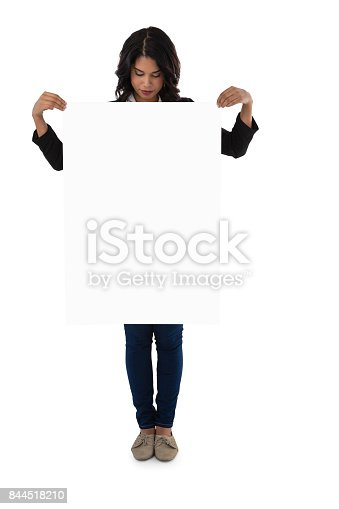157609352 istock photo Young businesswoman holding blank placard 844518210