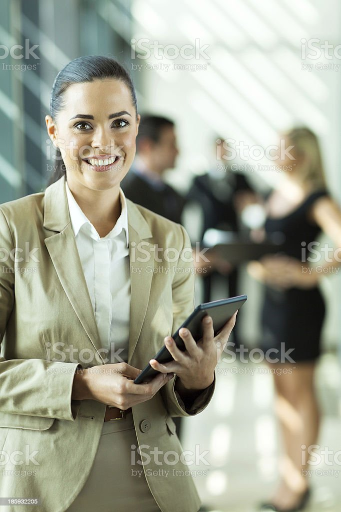 young businesswoman holding tablet computer royalty-free stock photo