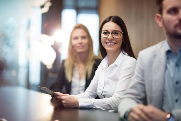Young businesswoman holding tablet in conference room stock photo