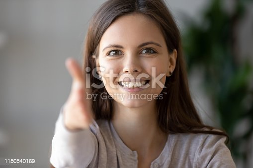 843963182 istock photo Young businesswoman holds out her hand to camera for handshake 1150540169
