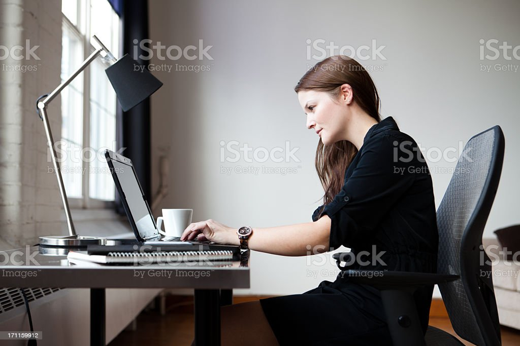 Young businesswoman in an office stock photo