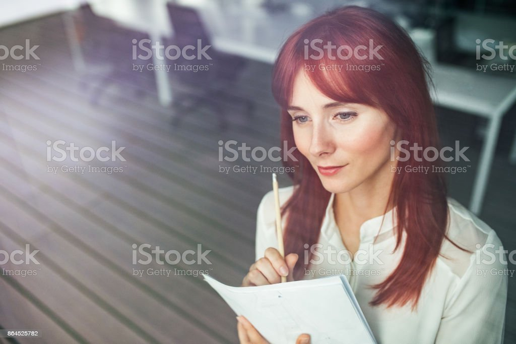Young businesswoman in her office working. stock photo