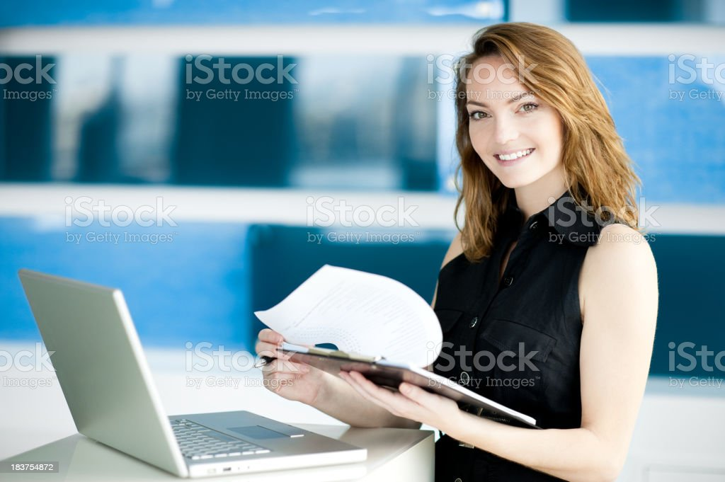 Young Businesswoman in Modern Office royalty-free stock photo