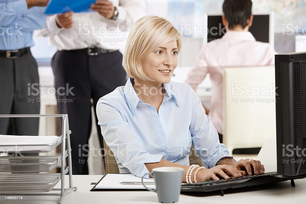Young businesswoman in office royalty-free stock photo