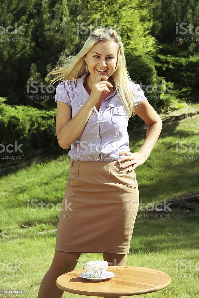 Young businesswoman invited you to drink coffee. stock photo