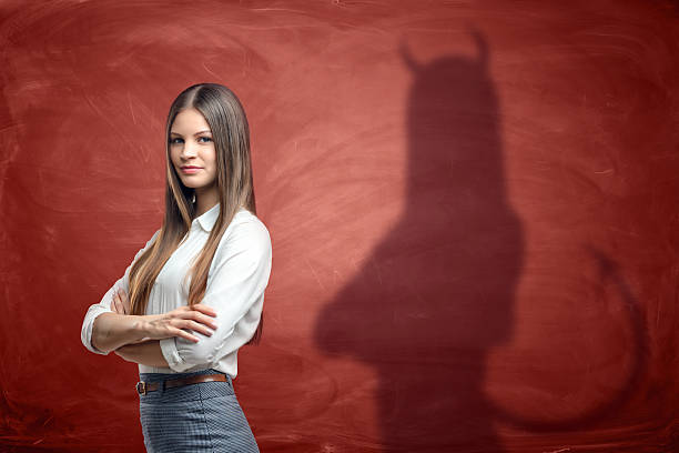 Young businesswoman is casting shadow of devil on rusty orange picture id627747210?b=1&k=6&m=627747210&s=612x612&w=0&h=i0km5ohvvr5ym1h1koibgtkly1tecs97wirihd79evo=